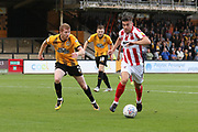 Brad Halliday and Sam Jones  during the EFL Sky Bet League 2 match between Cambridge United and Cheltenham Town at the Cambs Glass Stadium, Cambridge, England on 25 August 2018.