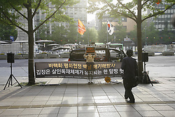 April 26, 2018 - Seoul, SOUTH KOREA - April 26, 2018-Seoul, South Korea-A South Korean conservative protester holds a flag during a rally against Inter Korean Summit in downtown on April 26, 2018 in Seoul, South Korea. The summit between South Korean President Moon Jae-in and North Korea's leader Kim Jong-un is scheduled on April 27, 2018 at the Joint Security Area in Panmunjom. (Credit Image: © Ryu Seung-Il via ZUMA Wire)