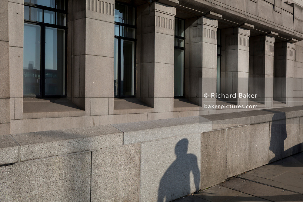 The shadow of a person against the architecture on the north end of London Bridge in the City of London - the capital's financial district, on 10th October 2018, in London, England.