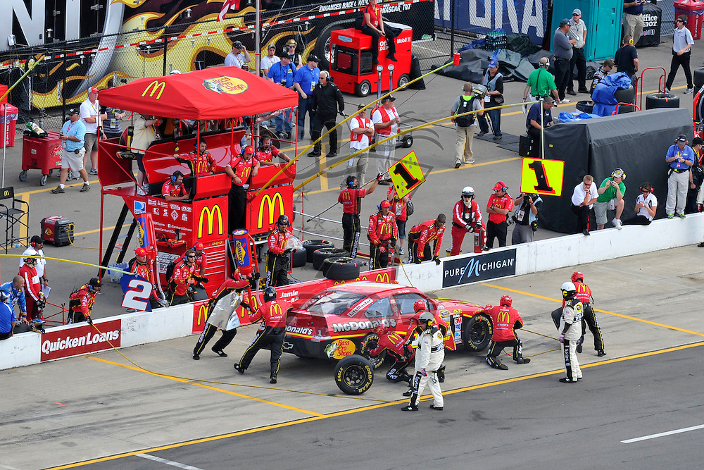 Brooklyn, MI - JUN 17, 2012: Jamie McMurray (1) makes a pit stop during race action for the Quicken Loans 400 race at the Michigan International Speedway in Brooklyn, MI.