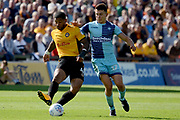 Newport County midfielder Joss Labadie (4) plays a pass watched by Wycombe Wanderers midfielder Luke O'Nien (17) 0-0 during the EFL Sky Bet League 2 match between Newport County and Wycombe Wanderers at Rodney Parade, Newport, Wales on 9 September 2017. Photo by Alan Franklin.