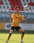Newport County player Tom Owen-Evans uses his chest to control the ball during the Sky Bet League 2 match between Dagenham and Redbridge and Newport County at the London Borough of Barking and Dagenham Stadium, London, England on 19 September 2015. Photo by Bennett Dean.