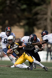 Virginia linebacker Antonio Appleby (58) tackles Wyoming wide receiver Hoost Marsh (6) on a punt return.  The Wyoming Cowboys defeated the Virginia Cavaliers 23-3 at War Memorial Stadium in Laramie, WY on September 1, 2007.