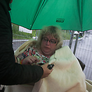 Day two of the Rolling Resistance, Preston New Road, Lancashire. Michelle Martin was part of a 13 strong lock-on the day. Everyone else were cut free by specialist the day before but because the police ran out of time Michelle managed to stay on.  By the time of being photographed Michelle has been in this spot locked on for 27.5 hours. She lasted 35.5hours before she was cut loose by a specialist protester removal team.The New Preston Road Quadrilla site is almost ready to start drilling for shale gas after many delays caused by local objections. Lancashire County council voted against fracking but the conservative central government forced it through.