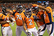 DENVER, CO - AUGUST 11:  Phillip Lindsay #2 of the Denver Broncos celebrates in the end zone with teammates after scoring a touchdown during preseason game week 1 against the Minnesota Vikings at Broncos Stadium at Mile High on August 11, 2018 in Denver, Colorado.  The Vikings defeated the Broncos 42-28.  (Photo by Wesley Hitt/Getty Images) *** Local Caption *** Phillip Lindsay