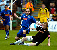 Photo: Ed Godden.<br />Barnet v Stockport County. Coca Cola League 2. 29/04/2006. Nicky Bailey (R), slides in on Stockport's Rob Clare.