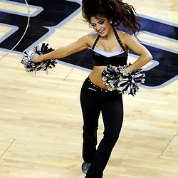 Jun 16, 2013; San Antonio, TX, USA; San Antonio Spurs cheerleader performs during the first quarter of game five in the 2013 NBA Finals against the San Antonio Spurs at the AT&T Center. Mandatory Credit: Derick E. Hingle-USA TODAY Sports