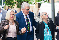 London, May 29th 2014. Veteran entertainer Rolf Harris, 84, arrives at Southwark Crown Court with his daughter Bindi, left, and his artist wife Alwen Hughes, as his defence against 12 charges of indecent assault against four girls aged 7 to 19 continues.