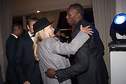 ANDREA BARRON; USAIN BOLT, Fundraising Gala for the Zeitz foundation and Zoological Society of London hosted by Usain Bolt. . London Zoo. Regent's Park. London. 22 November 2012.