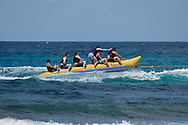 A group of holiday makers riding on a rubber 'banana' boat off the West Coast of<br /> Barbados