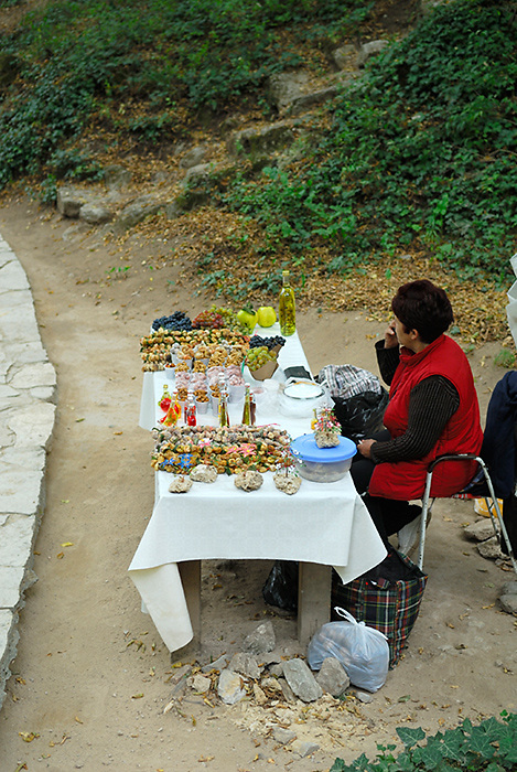 Local woman with stall selling produce, Krka National Park, Croatia