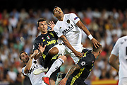 Jeison Murillo of Valencia CF and Mario Mandzukic of Juventus FC jump to head the ball during the UEFA Champions League, Group H football match between Valencia CF and Juventus FC on September 19, 2018 at Mestalla stadium in Valencia, Spain - Photo Manuel Blondeau / AOP Press / ProSportsImages / DPPI