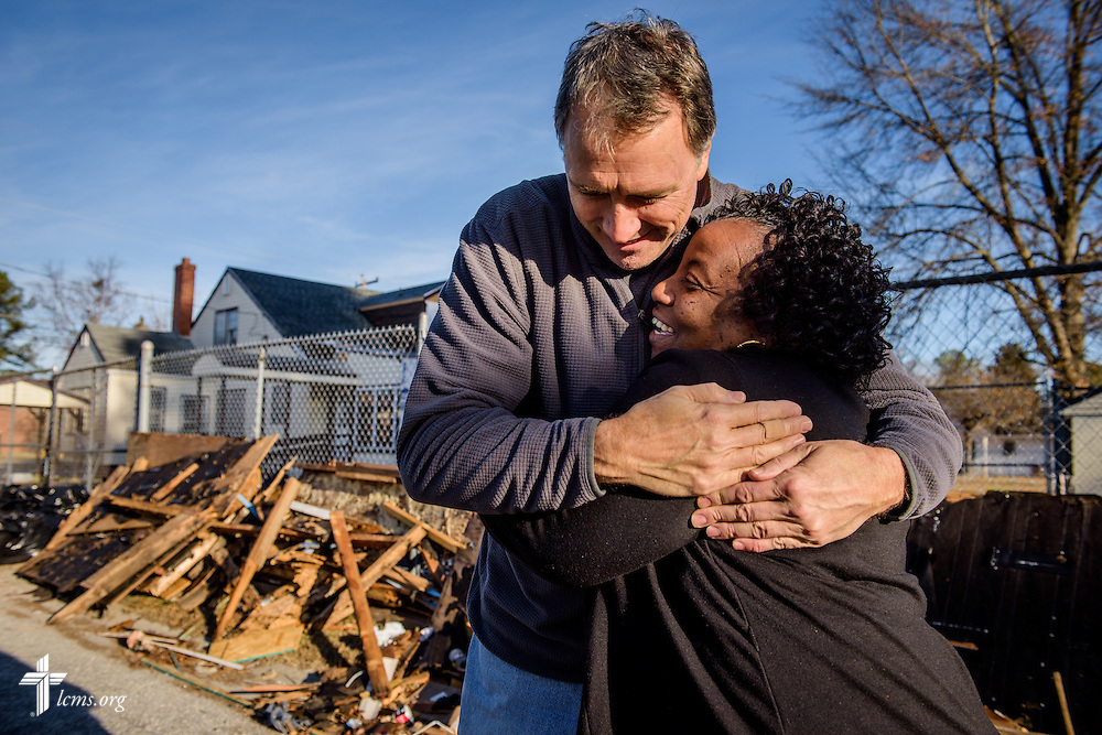The Rev. Wayne Puls, senior pastor at Hope Lutheran Church, Wake Forest, N.C., hugs Bernice Cromartie at her daycare, Nanny's Korner Care Center, on Thursday, Jan. 19, 2017, in Lumberton, N.C. The center was damaged in October from flooding related to Hurricane Matthew. Members of Hope are part of several congregations rebuilding the daycare. LCMS Communications/Erik M. Lunsford