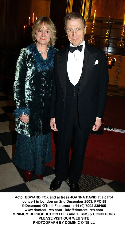 Actor EDWARD FOX and actress JOANNA DAVID at a carol concert in London on 2nd December 2003.PPC 99