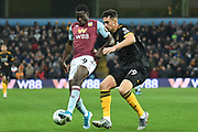 Aston Villa striker Keinan Davis (39) battles for possession  with Wolverhampton Wanderers defender Max Kilman (49) during the EFL Cup match between Aston Villa and Wolverhampton Wanderers at Villa Park, Birmingham, England on 30 October 2019.