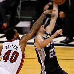 Jun 6, 2013; Miami, FL, USA; San Antonio Spurs shooting guard Manu Ginobili (20) is fouled by Miami Heat power forward Udonis Haslem (40) in the first quarter during game one of the 2013 NBA Finals at the American Airlines Arena. Mandatory Credit: Derick E. Hingle-USA TODAY Sports