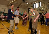 Matt Swormstedt, Pan Pradachith, Sharon Morningstar-Leonard and Ann Emerson hit the dance floor at the Laconia Community Center during Laconia High School's Hawaiian themed Senior/Senior prom Thursday evening.  (Karen Bobotas/for the Laconia Daily Sun)