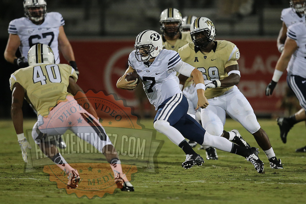 ORLANDO, FL - OCTOBER 09:  Quarterback Christian Stewart #7 of the Brigham Young Cougars scrambles with the football at Bright House Networks Stadium on October 9, 2014 in Orlando, Florida. (Photo by Alex Menendez/Getty Images) *** Local Caption ***Christian Stewart