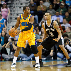 January 22, 2011; New Orleans, LA, USA; New Orleans Hornets point guard Chris Paul (3) is defended by San Antonio Spurs point guard George Hill (3) during the third quarter at the New Orleans Arena. The Hornets defeated the Spurs 96-72.  Mandatory Credit: Derick E. Hingle