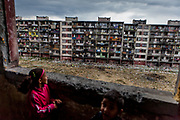 "Children looking out of the decrepit highrise building ""Hrebenova 34-36"" which was demolished by the city of Kosice in August 2014. The Lunik IX housing estate is home to the largest Roma community in Slovakia. It is located a few kilometers away from the historical city centre, on the outskirts of the eastern Slovakian city of Kosice. Since the beginning of the 1980s a large number of the Roma residents living in the city and in nearby settlements have been moved to Lunik IX. Lunik IX has officially 6542 registered (12/2015) inhabitants and almost all of them are of Roma ethnicity."