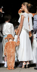 Cara Delevingne at her sister Poppy's wedding at St.Paul's Church in Knightsbridge, London , Friday, 16th May 2014. Picture by Stephen Lock / i-Images
