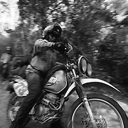 Billy Fritz, of Franklin, Pennsylvania, drives his motorbike along the Ho Chi Minh Trail in Laos. Fritz, a 60-year old orthopedic surgeon and commercial helicopter pilot, was a 1st lieutenant combat engineer company commander during the Vietnam War, serving in 1967-68.