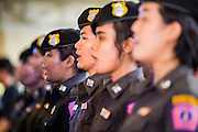 """15 JUNE 2014 - BANGKOK, THAILAND: A Thai police choir performs on a stage during a """"Return Happiness to Thais"""" party in Lumpini Park in Bangkok. The Thai military junta, formally called the National Council for Peace and Order (NCPO), is sponsoring a series of events throughout Thailand to restore """"Happiness to Thais."""" The events feature live music, dancing girls, military and police choirs, health screenings and free food.   PHOTO BY JACK KURTZ"""