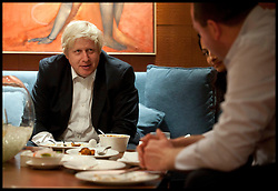 London Mayor Boris Johnson has a curry on the forth day of a six-day tour of India, where he will be trying to persuade Indian businesses to invest in London, Wednesday November 28, 2012. Photo by Andrew Parsons / i-Images