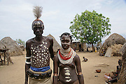 Africa, Ethiopia, Omo Valley, Karo tribe man and woman in traditional dress and body art
