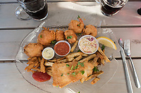 The neighborhood restaurant of Fish O Chips in Sidney, BC, serves up an assortment of seafood and chips on a sunny outdoor patio.
