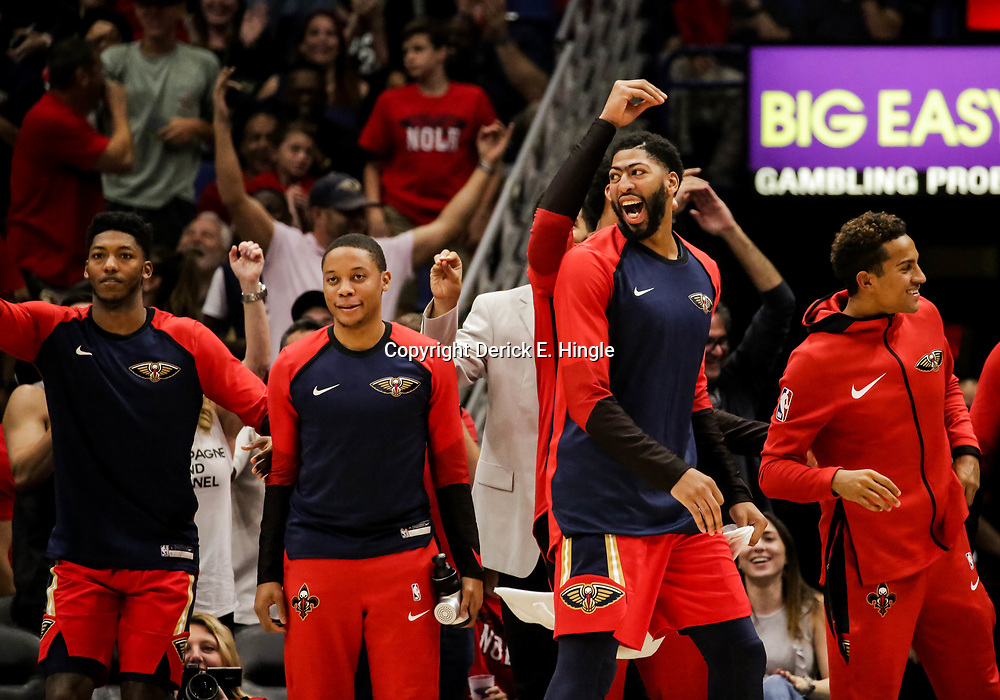 Oct 19, 2018; New Orleans, LA, USA; New Orleans Pelicans forward Anthony Davis (center) reacts after a basket by forward Nikola Mirotic (not pictured) during the second half against the Sacramento Kings at the Smoothie King Center. The Pelicans defeated the Kings 149-129. Mandatory Credit: Derick E. Hingle-USA TODAY Sports