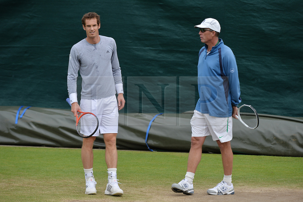 © London News Pictures.. 28/06/2013. Andrew Murray practices under the watchful eye of his coach Ivan Lendl during the 2013 Wimbledon Lawn Tennis Championships. Andy Murray went on to win in the final becoming the first British male to win the tournament in 77 years. Photo credit: Mike King/LNP