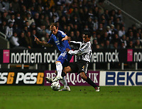 Photo: Andrew Unwin.<br /> Newcastle United v Chelsea. Carling Cup. 20/12/2006.<br /> Newcastle's Nolberto Solano (R) looks to tackle Chelsea's Arjen Robben (L).