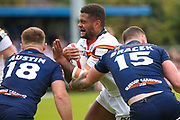 Bradford Bulls prop Colton Roche (11) is tackled during the Kingstone Press Championship match between Swinton Lions and Bradford Bulls at the Willows, Salford, United Kingdom on 20 August 2017. Photo by Simon Davies.