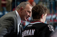 KELOWNA, CANADA -FEBRUARY 5: Head coach Brent Sutter of the Red Deer Rebels speaks to goalie Taz Burman #30 after pulling him in the first period against the Kelowna Rockets on February 5, 2014 at Prospera Place in Kelowna, British Columbia, Canada.   (Photo by Marissa Baecker/Getty Images)  *** Local Caption *** Brent Sutter; Taz Burman;