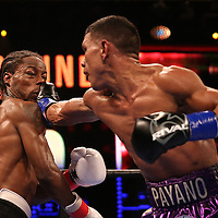 WINTER PARK, FL - AUGUST 02: Juan Carlos Payano (R) lands a right hand to the face of Rau'shee Warren during the Premier Boxing Champions on Bounce TV boxing match at Full Sail University - Ebbs Auditorium on August 2, 2015 in Winter Park, Florida. Payano won the bout and retained his WBA and IBO  bantamweight title. (Photo by Alex Menendez/Getty Images) *** Local Caption *** Juan Carlos Payano; Rau'shee Warren