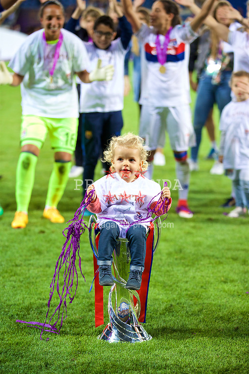 CARDIFF, WALES - Thursday, June 1, 2017: Olympique Lyonnais players celebrate with a child in the trophy after winning the UEFA Champions League following a penalty-shoot out victory during the UEFA Women's Champions League Final between Olympique Lyonnais and Paris Saint-Germain FC at the Cardiff City Stadium. (Pic by David Rawcliffe/Propaganda)
