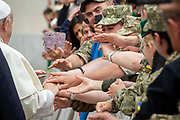Pope Francis greets a group of Ukrainian soldiers at the end of his weekly general audience on May 23; 2018 in St. Peter's Square at the Vatican.