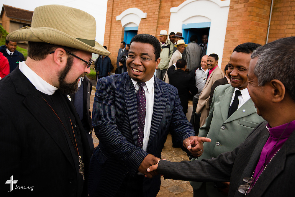 The Rev. Dr. Albert Collver, LCMS Director of Church Relations, greets guests after the opening of the synodical convention for the Fiangonana Loterana Malagasy at a Lutheran church near Antsirabe, Madagascar, on Wednesday, Feb. 5, 2014. LCMS Communications/Erik M. Lunsford