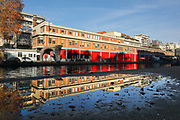 Caserne des Sapeurs Pompiers, a fire station on the Quai de Valmy on the Canal Saint-Martin, in the 10th arrondissement of Paris, France. The Canal Saint-Martin is a 4.6km long waterway between the Canal de l'Ourcq and river Seine, built 1802-25 to provide a fresh water source to the city and provide a trade route for canal barges. Picture by Manuel Cohen