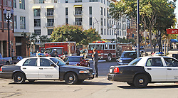 squad cars and ambulances blocking intersection where a vehicular accident has taken place