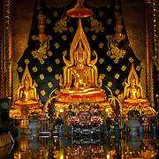 Wat Neramit Wiphatsana in Loei,.Dedicated to a popular local monk and very reminiscent of some of the larger temples in Bangkok, Wat Neramit Wiphatsana was built for meditating monks and is located on a hill near Phra That Si Song Rak southwest of Loei. The temple?s ordination hall and pagoda are made of laterite and illustrated with murals created by Pramote Sriphrom ? a famous muralist who has already spent a number of years working on the temple.