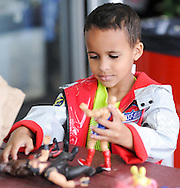 Brayden Bonay, 5 of Burlington, New Jersey plays with some new toduring the grand reopening of the Columbus Farmers Market Saturday May 21, 2016 in Columbus, New Jersey. (Photo by William Thomas Cain)
