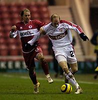 Photo: Jed Wee.<br /> Middlesbrough v Stuttgart. UEFA Cup. 23/02/2006.<br /> <br /> Stuttgart's Ludovic Magnin (R) takes on Middlesbrough's Gaizka Mendieta.