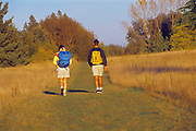 Hikers on trail<br />Birds Hill Provincial Park<br />Manitoba<br />Canada