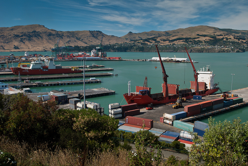 Cargo vessel Spirit of Resolution unloads containers onto the wharf at Lyttelton Harbour, New Zealand, with Antarctic exploration vessel Araon berthed nearby