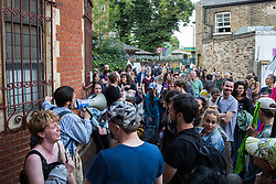 London, UK. 18 July, 2019. Climate activists from Extinction Rebellion decide how to proceed after Heathrow's 'masterplan' consultation event in Lambeth is closed to the public half an hour before the scheduled time following an earlier peaceful, non-violent protest by Extinction Rebellion against plans for a third runway at Heathrow airport and to highlight Heathrow airport's major contribution to climate change.