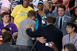 Philadelphia, Pennsylvania, USA - July 29, 2016; A single heckler is spotted in the crowd attending a Post-DNC campaign event of Democratic presidential nominee former Secretary of State Hillary Clinton, joined by Democratic vice presidential nominee U.S. Sen. Tim Kaine at Temple University in Philadelphia, PA at which they commence on a joined bus tour, kicking of the lasting 100-days till the General Elections.