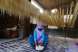 June 11, 2017 - Jaipur, Rajasthan, India - An Indian muslim Mansoori family woman member prepares Vermicelli or Sewaiyan for sale in her residence for the forthcoming Muslim Eid festival, marking the end of the holy month of Ramadan, at Ramganj Bazar in Jaipur,Rajasthan, India, 11 June 2017. Muslims around the world celebrate the holy month of Ramadan by praying during the night time and abstaining from eating and drinking during the period between sunrise and sunset. Ramadan is the ninth month in the Islamic calendar and it is believed that the Koran's first verse was revealed during its last 10 nights. (Photo By Vishal Bhatnagar/NurPhoto) (Credit Image: © Vishal Bhatnagar/NurPhoto via ZUMA Press)