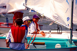 Stock photo of young boys sitting in sailboats